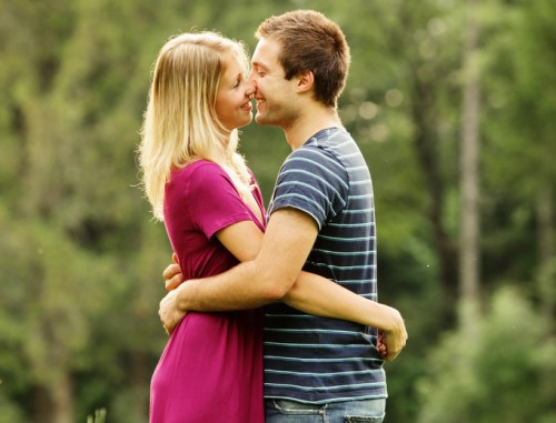 Romantic Couple Kissing in Field